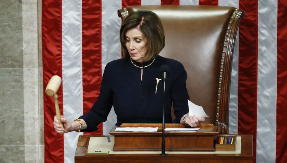 House Speaker Nancy Pelosi of California strikes the gavel after announcing the passage of article II of impeachment against President Trump on Wednesday. (Patrick Semansky/AP)