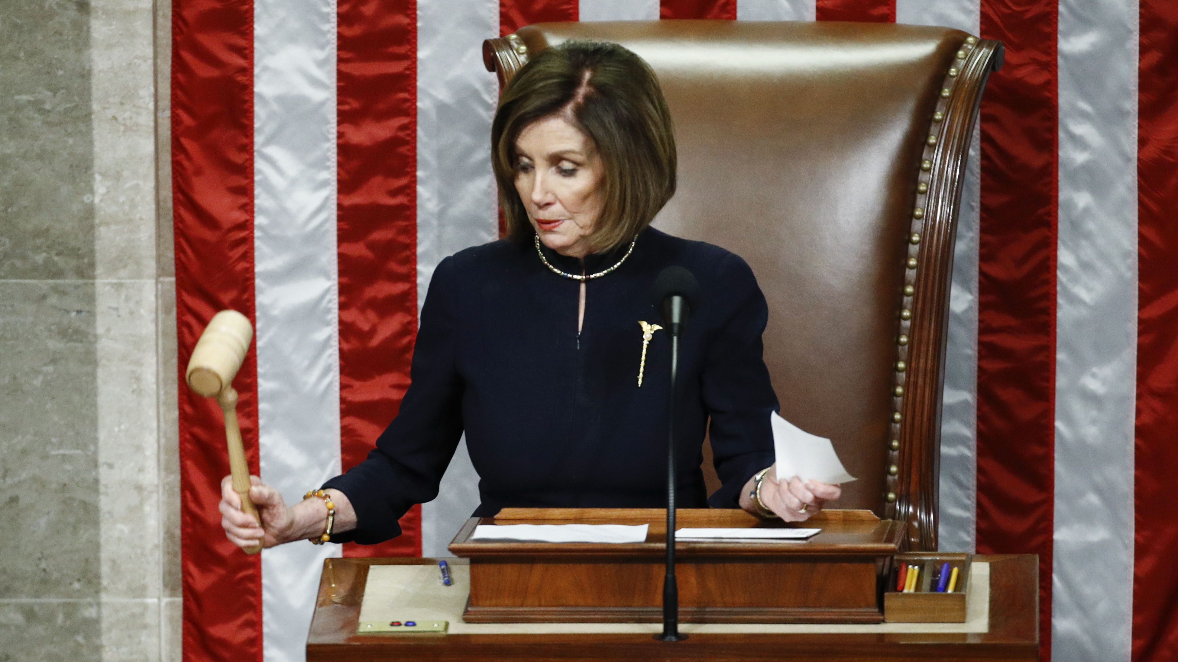 House Speaker Nancy Pelosi of California strikes the gavel after announcing the passage of article II of impeachment against President Trump on Wednesday.