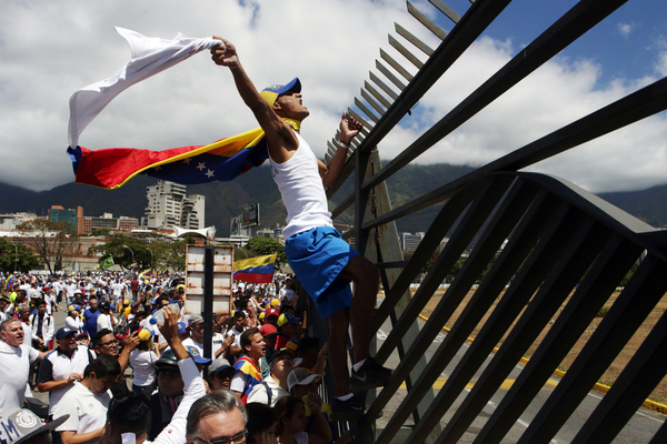 Supporters of Venezuelan opposition leader Juan Guaidó take part in a march in Caracas in February 2019. Amid Venezuela's isolation and catastrophic economic conditions, Guaidó emerged as a key challenger to Nicolás Maduro's rule, but has had difficulty sustaining his initial mass momentum in support.