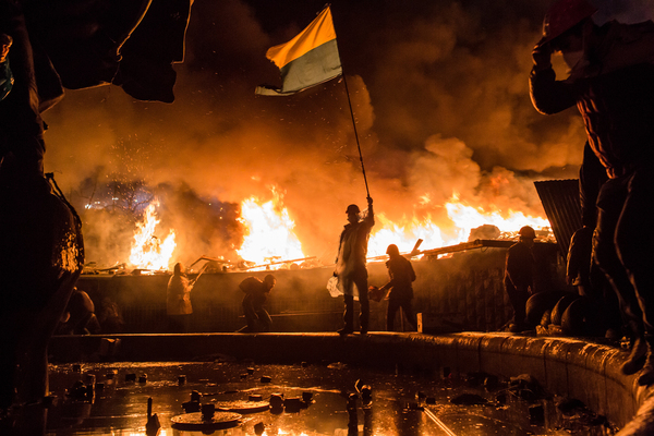 Amid fires set around Independence Square, known as the Maidan, in Kyiv, Ukraine, protesters demonstrate against the government of then-President Viktor Yanukovych in February 2014. Protesters called for Yanukovych's ouster over allegations of corruption and abandoning a trade agreement with the European Union.