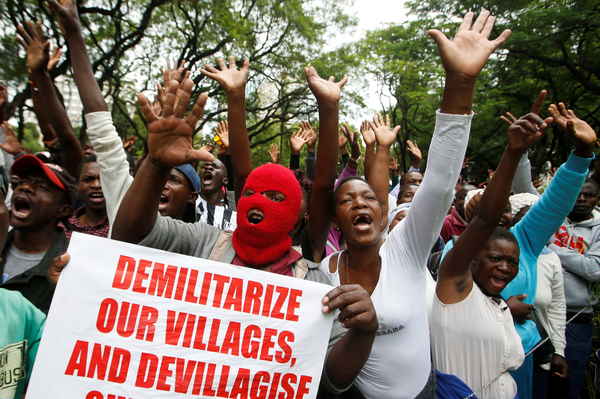 Supporters of Zimbabwe's opposition Movement for Democratic Change march in Harare, November 2018, angered by a protracted economic crisis and Prime Minister Emmerson Mnangagwa's election earlier that year.