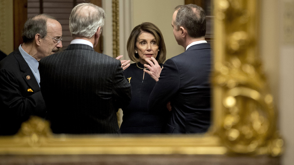 House Speaker Nancy Pelosi speaks with House Intelligence Committee Chairman Adam Schiff (right), House Foreign Affairs Committee Chairman Eliot Engel (left) and House Ways and Means Committee Chairman Richard Neal after the House voted to impeach President Trump on Dec. 18. (Andrew Harnik/AP)