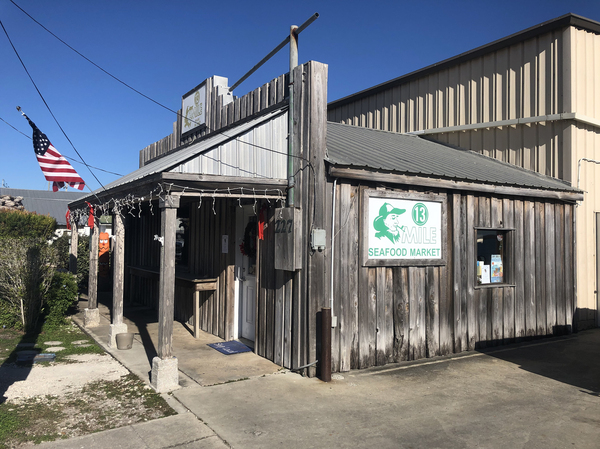 13 Mile Seafood is one of the few seafood-processing plants that are still open in the area.
