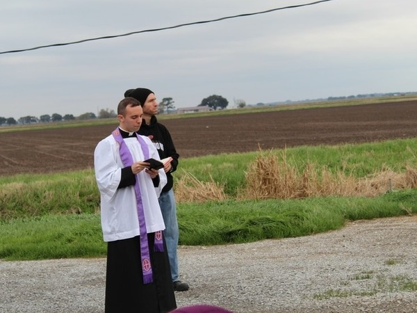 Rev. Matthew Barzare of St. Anne Church in Cow Island, La., on Saturday, just before a crop duster plane sprinkled 100 gallons of holy water across the community.