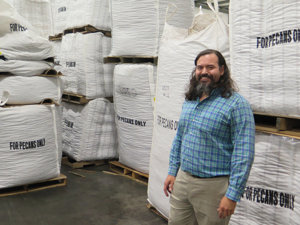 Christopher Worsham stands in his warehouse filled with Georgia pecans. Because of the droughts and the lawsuits, Georgia had to take a hard look at the water it uses for farming. It has placed a moratorium on new wells for agriculture and is requiring all farmers to move to more efficient irrigation systems.