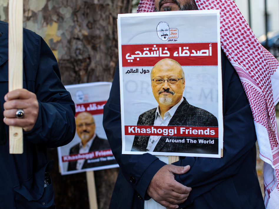 Protesters outside the Saudi Arabian Embassy in London in October 2018 demonstrate against the killing of journalist Jamal Khashoggi. On Monday, five people were sentenced to death for the killing, and three others received prison sentences. (Jack Taylor/Getty Images)