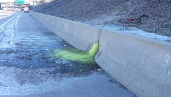 Environmental safety officials in Michigan say they think they have determined the source of a mysterious green slime that seeped onto an interstate on Friday.
