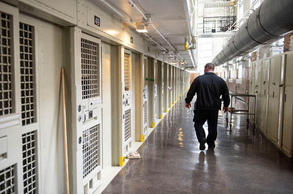 Lt. Keith Immerfall walks past prison cells at Waupun Correctional Institution, a maximum security prison in Waupun, Wis. If the more than 1,200 prisoners at the facility are still incarcerated there on April 1, the next Census Day, the Census Bureau will officially consider them residents of Waupun for the 2020 national head count.
