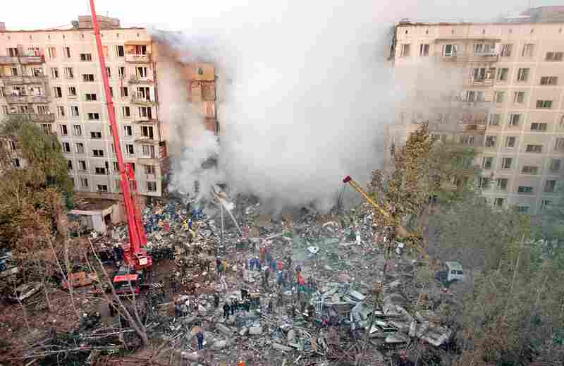 Fire and smoke rise from a destroyed apartment building as Russian firefighters try to save people in Moscow on Sept. 9, 1999. This was just one of several apartment bombings the Russian government blamed on Chechen militants. But some believe Boris Yeltsin, Vladimir Putin, and the FSB ordered the bombings to help get Putin elected as President.