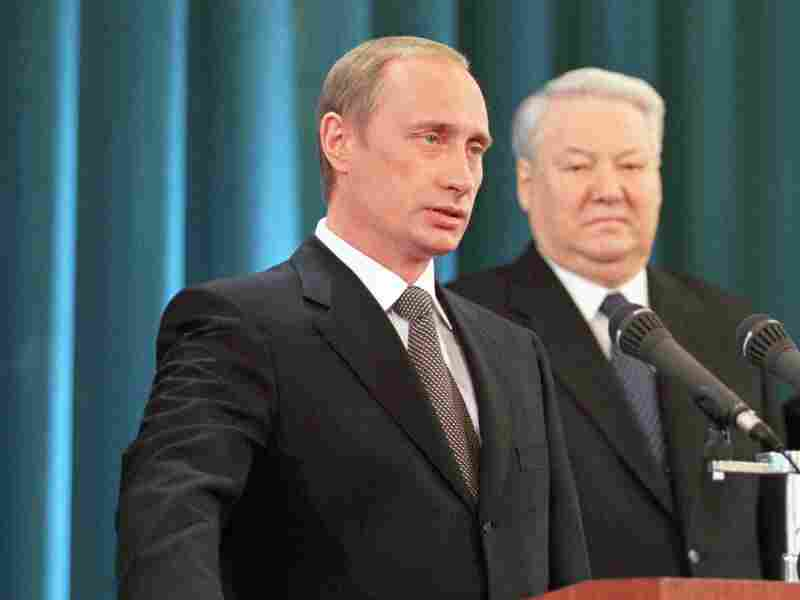 New Russian President Vladimir Putin takes the presidential oath on the Constitution of the Russian Federation in Moscow's Kremlin Palace on May 7, 2000. Former president Boris Yeltsin looks on during the inauguration ceremony after having resigned on December 31, 1999.