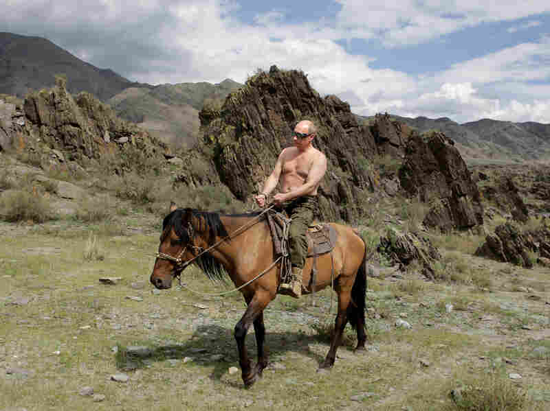 Then Russian Prime Minister Vladimir Putin rides a horse during his vacation in Southern Siberia on August 3, 2009. Since rising to power, Putin has been able to control and use Russian media as a propaganda tool.