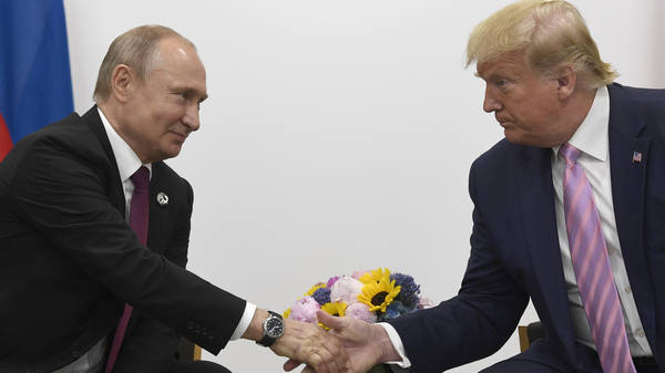 President Trump shakes hands with Russian President Vladimir Putin during a meeting on the sidelines of the Group of 20 summit in Osaka, Japan, in June 2019.