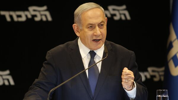 Israeli Prime Minister Benjamin Netanyahu speaks at a press conference Wednesday in Jerusalem regarding his intention to file a request to the Knesset for immunity from prosecution.