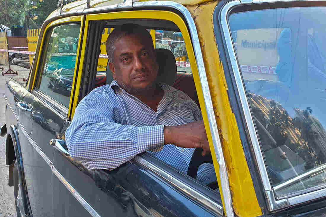 Westlake Legal Group pathak_taxi8_custom-e2074099067f8e68286ec169432eea2c2a56c5b4-s1100-c15 Mumbai Takes Its Vintage Padmini Taxis Off The Road For Good