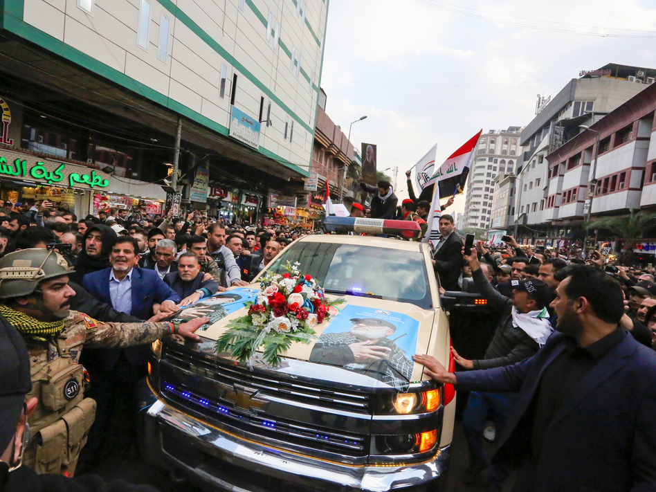 Mourners surround a vehicle carrying the coffins of Iranian Maj. Gen. Qassem Soleimani and Iraqi militia leader Abu Mahdi al-Muhandis, during a funeral procession Saturday in Baghdad. (Sabah Arar/AFP via Getty Images)