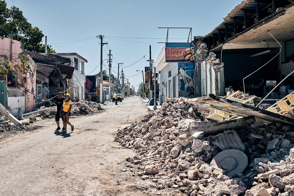 Businesses and homes were severely damaged in the town center of Guanica, Puerto Rico, after an earthquake on Tuesday. The quake, just the latest in a series of temblors to hit the region, crumbled walls and destroyed houses. (Christopher Gregory for NPR)