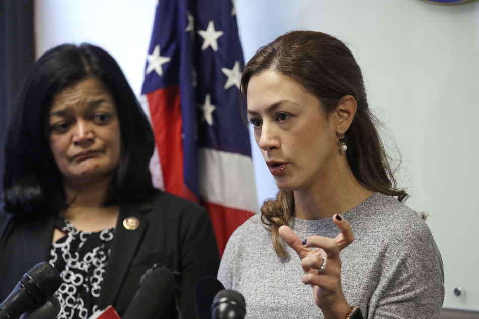 Rep. Pramila Jayapal, D-Wash., looks on as Negah Hekmati talks about her hours-long delay returning to the U.S. from Canada with her family days earlier, at a news conference on Monday. (Elaine Thompson/AP)