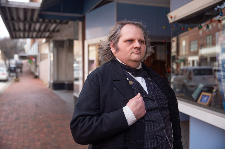 """Joe Aldridge, 43, poses for a portait in his Andrew Johnson costume, a role he has played in his hometown, Greeneville, Tenn., for the past 11 years. Aldridge said he keeps his uniform in the closet of his work place, Tipton's Cafe, just in case he needs it: """"I hope that people will continue the legacy, help out other people and vote for their choice."""" (Jessica Tezak for NPR)"""