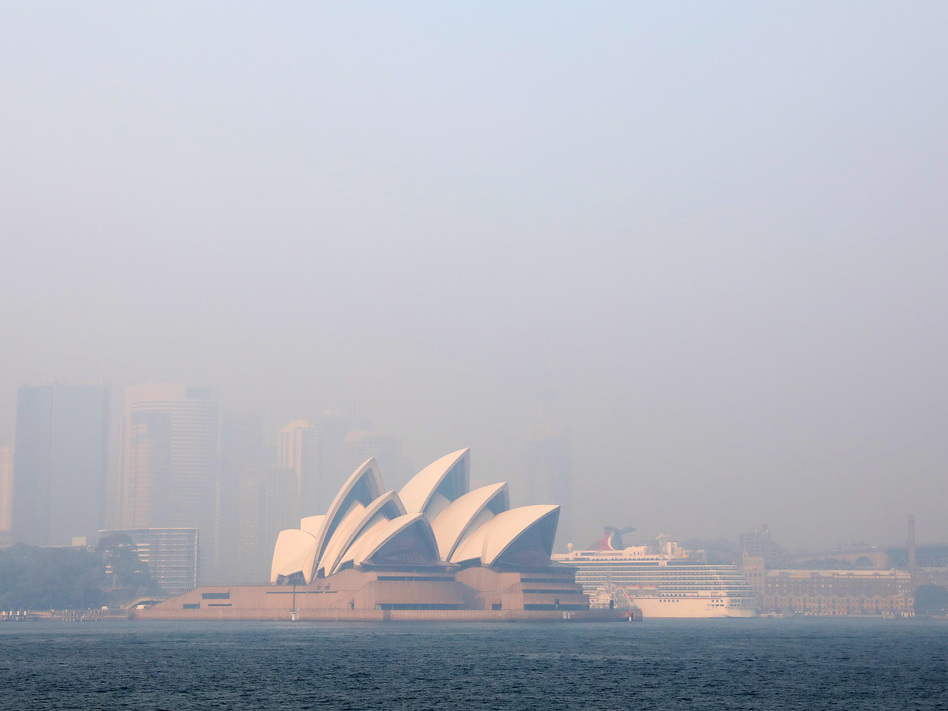 Much of New South Wales, Australia, including the Sydney Opera House, lay under a shroud of smoke Thursday. The state remains under severe or very high fire danger warnings as more than 60 fires continue to burn within its borders. (Cassie Trotter/Getty Images)