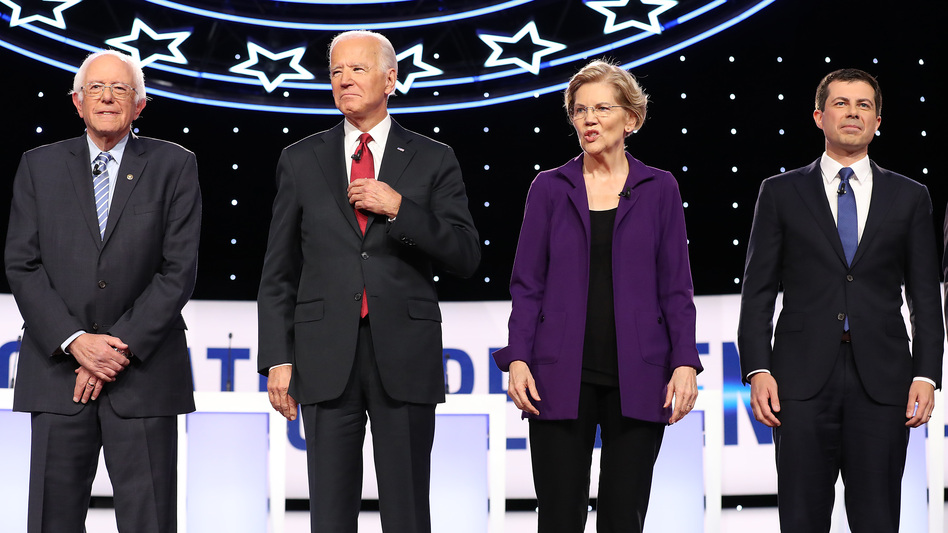 Bernie Sanders, Joe Biden, Elizabeth Warren and Pete Buttigieg appear at the start of the Democratic debate at Otterbein University on Oct. 15 in Ohio. The four enter Tuesday's debate as the top contenders in Iowa. (Chip Somodevilla/Getty Images)