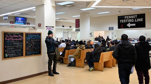 DMV offices around the U.S. were slowed down for hours on Monday, due to a network outage in a key database. Here, people wait at the New York State Department of Motor Vehicles office in  Brooklyn last month.