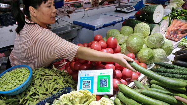 Alipay and WeChat QR codes for online payment are displayed at a vegetable stall in Nantong in China