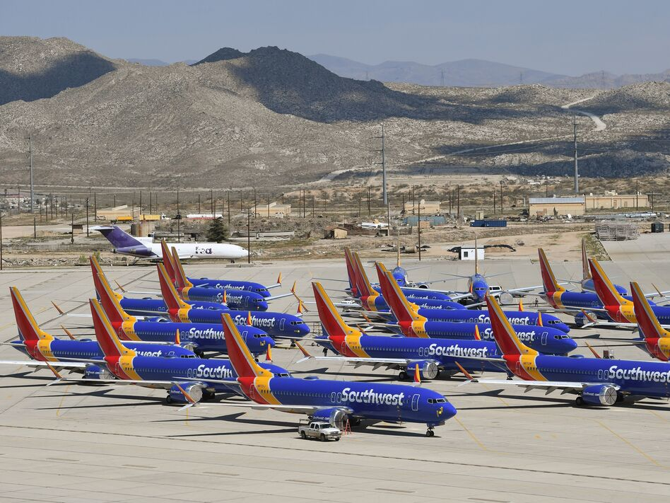 Boeing 737 Max planes are parked on the tarmac after the jets were grounded because of two crashes. (Mark Ralston /AFP via Getty Images)