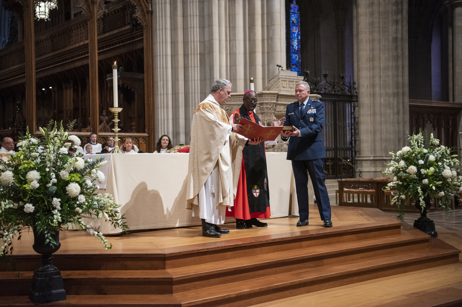 The Rev. Randolph Hollerith, dean of the Washington National Cathedral (from left); the Rt. Rev. Carl Wright, the Episcopal Church's bishop suffragan for the armed forces; and Maj. Gen. Steven Schaick, the Air Force chief of chaplains, participate in the blessing of a Bible for swearing in U.S. Space Force officials. (Danielle E. Thomas/Washington National Cathedral)
