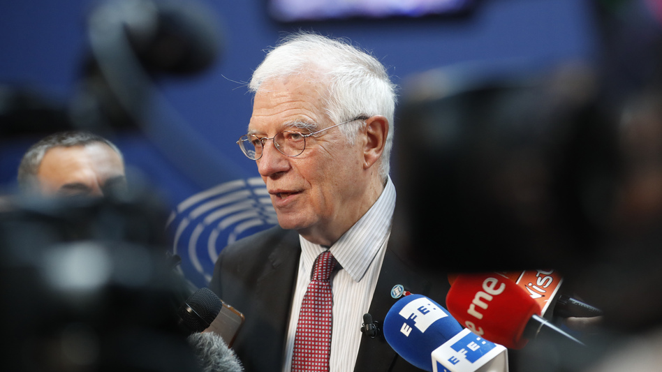 The European Union's foreign policy chief, Josep Borrell, talks to reporters Tuesday at the European Parliament<em> </em>in Strasbourg, France. The same day, the U.K., France and Germany announced they were lodging a dispute against Tehran under the Joint Comprehensive Plan of Action, or JCPoA, better known as the Iran nuclear deal. (Jean-Francois Badias/AP)