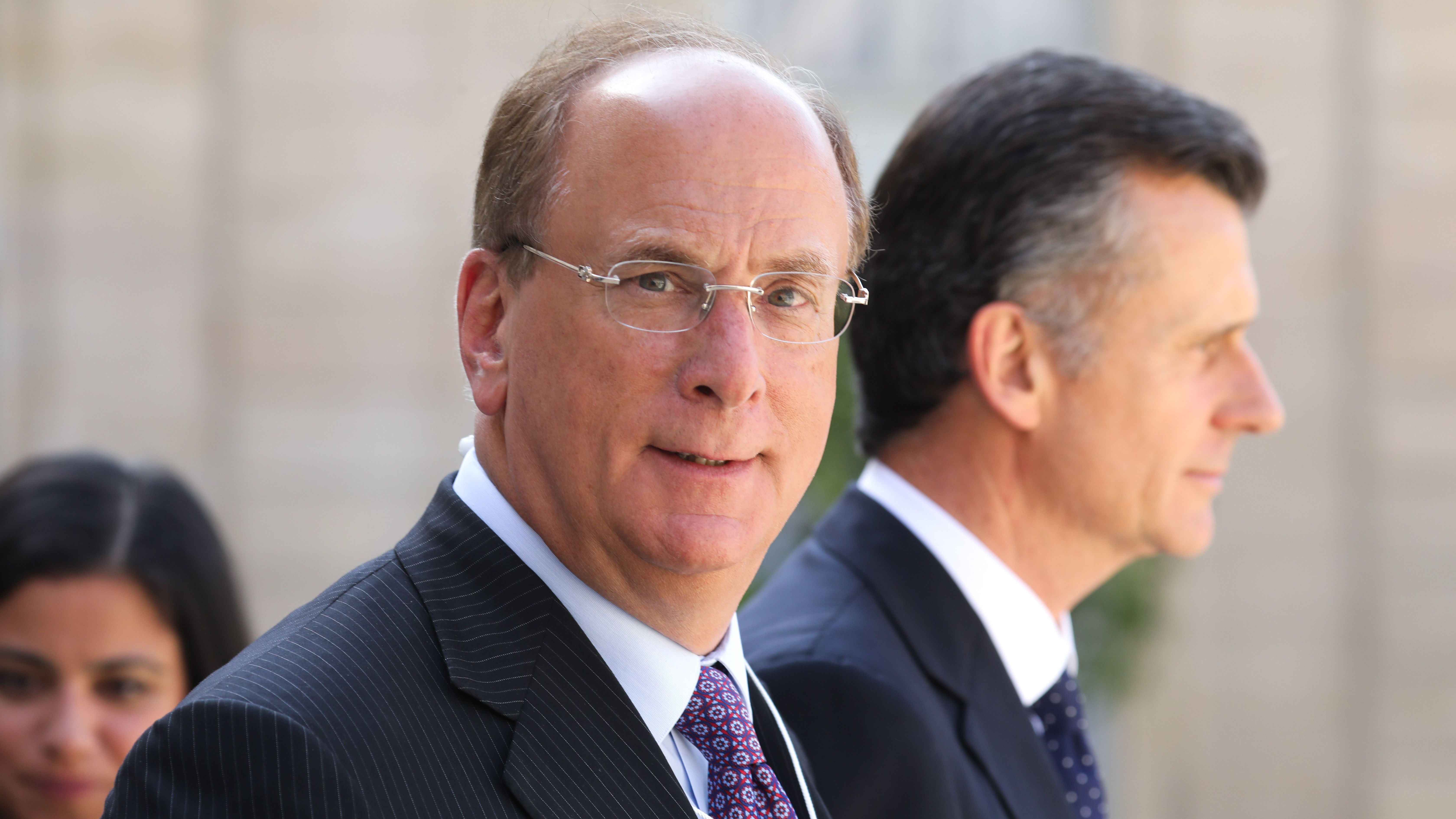 "BlackRock Chairman and CEO Larry Fink, seen here in Paris in July, wrote in his annual letter to CEOs that climate change will soon cause ""a significant reallocation of capital."""