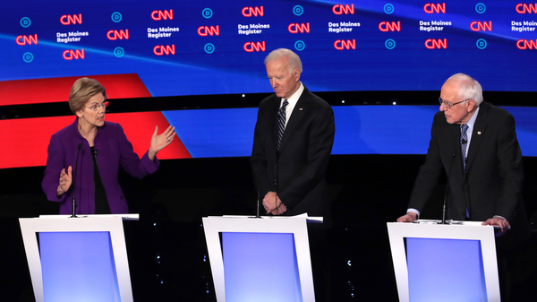 Democratic presidential candidates, left to right, Sen. Elizabeth Warren of Massachusetts, former Vice President Joe Biden and Sen. Bernie Sanders of Vermont participate in Tuesday night's primary debate in Des Moines, Iowa.