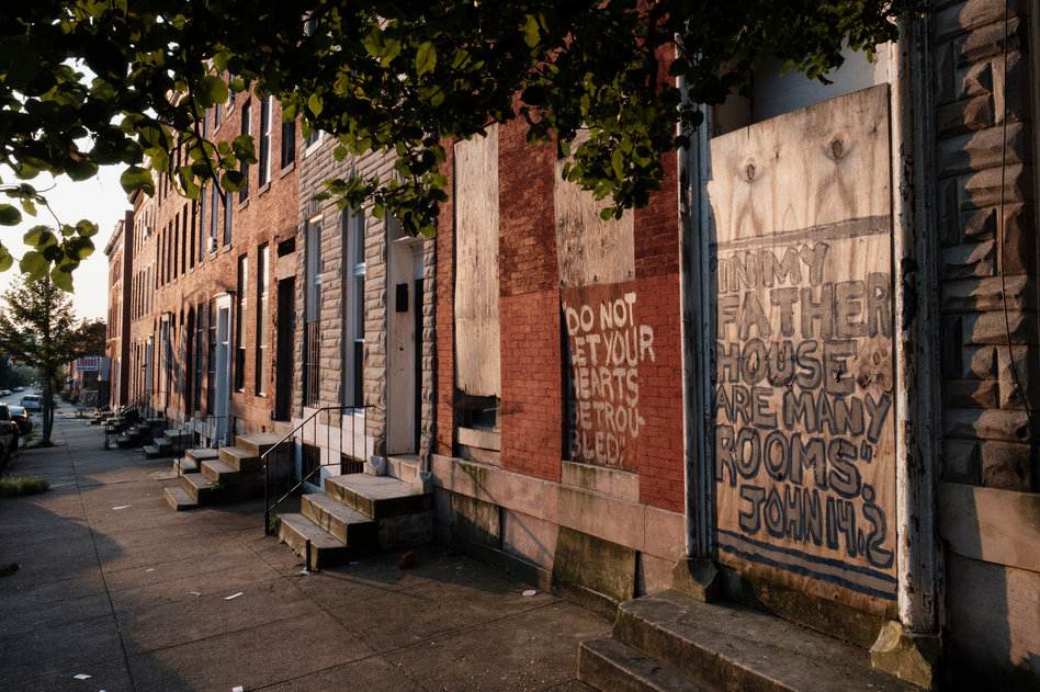 Vacant rowhouses line a portion of Franklin Square, a formerly redlined neighborhood in Baltimore. New research shows many communities subjected to discriminatory housing practices in the 1930s are hotter today. (Ian Morton for NPR)