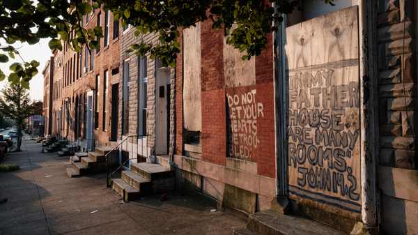 Vacant rowhouses line a portion of Franklin Square, a formerly redlined neighborhood in Baltimore. New research shows many communities subjected to discriminatory housing practices in the 1930s are hotter today.