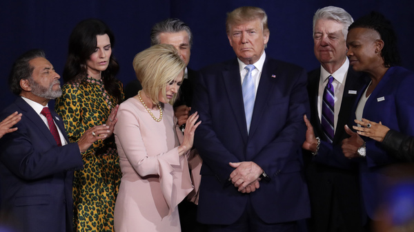 Faith leaders pray with President Trump during a rally for evangelical supporters at the King Jesus International Ministry church in Miami earlier this month.