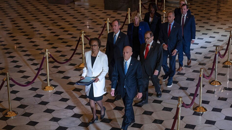 House impeachment managers walk to the Senate to deliver the articles of impeachment against President Trump on Capitol Hill on Wednesday (Jim Watson/AFP via Getty Images)