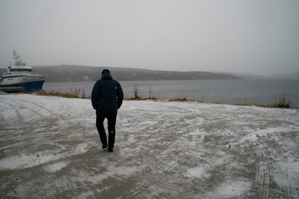 Rune Rafaelsen walks toward the harbor of Kirkenes, Norway. Rafaelsen is the mayor of a municipality including this town of about 3,500 people in the far northeastern corner of Norway, close to the Russian border.