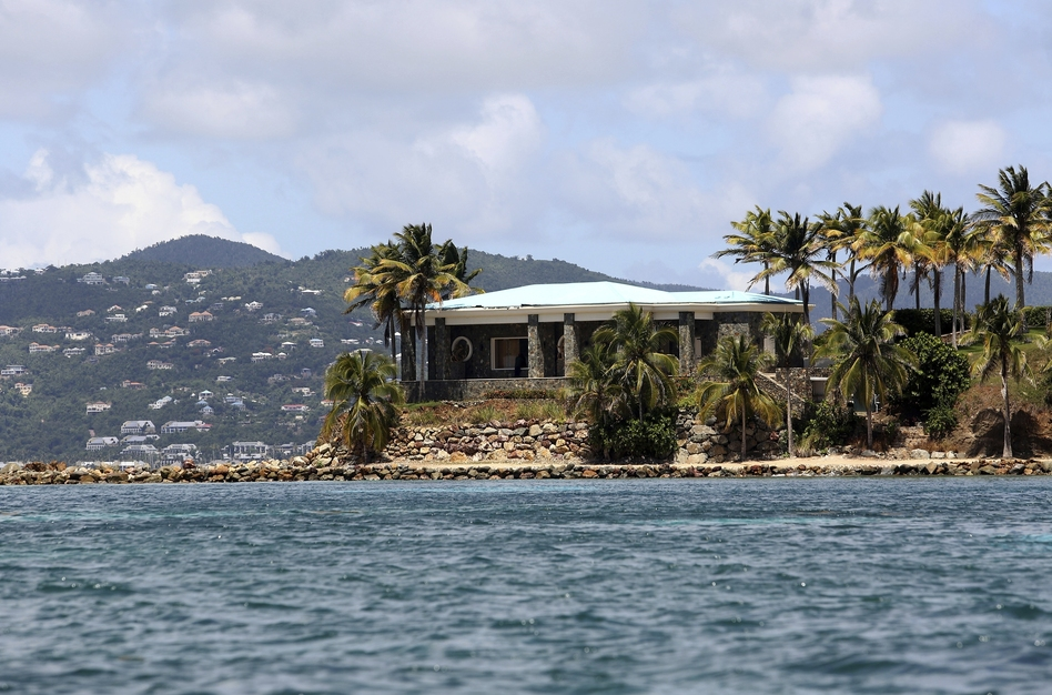 A view of Jeffrey Epstein's mansion on Little St. James Island. Prosecutors filed a civil lawsuit that accuses Epstein of human trafficking that victimized young women and children as young as 11. (Gabriel Lopez Albarran/AP)