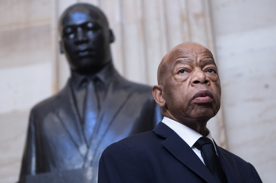 Georgia Rep. John Lewis near the statue of Martin Luther King Jr. in the Capitol Rotunda in Washington, D.C., earlier this year. At StoryCorps in 2018, Lewis talked about meeting King in Montgomery, Ala., at 18. (Tom Williams/CQ-Roll Call via Getty Image)