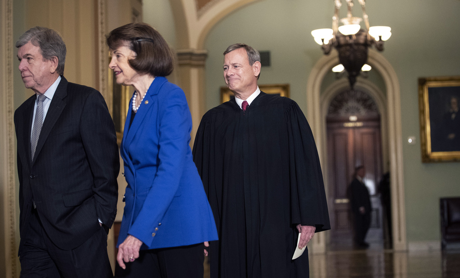 Sen. Roy Blunt, R-Mo. (left); Sen. Dianne Feinstein, D-Calif.; and Supreme Court Chief Justice John Roberts arrive to the Senate chamber for impeachment proceedings on Thursday. (Drew Angerer/Getty Images)