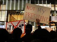 NEW YORK, NY - NOVEMBER 10: Dozens of anti-Donald Trump protesters stand along 5th Avenue in front of Trump Tower as New Yorkers react for a second night to the election of Trump as president of the United States on November 10, 2016 in New York City. Trump defeated Democrat Hillary Clinton to become the 45th president.