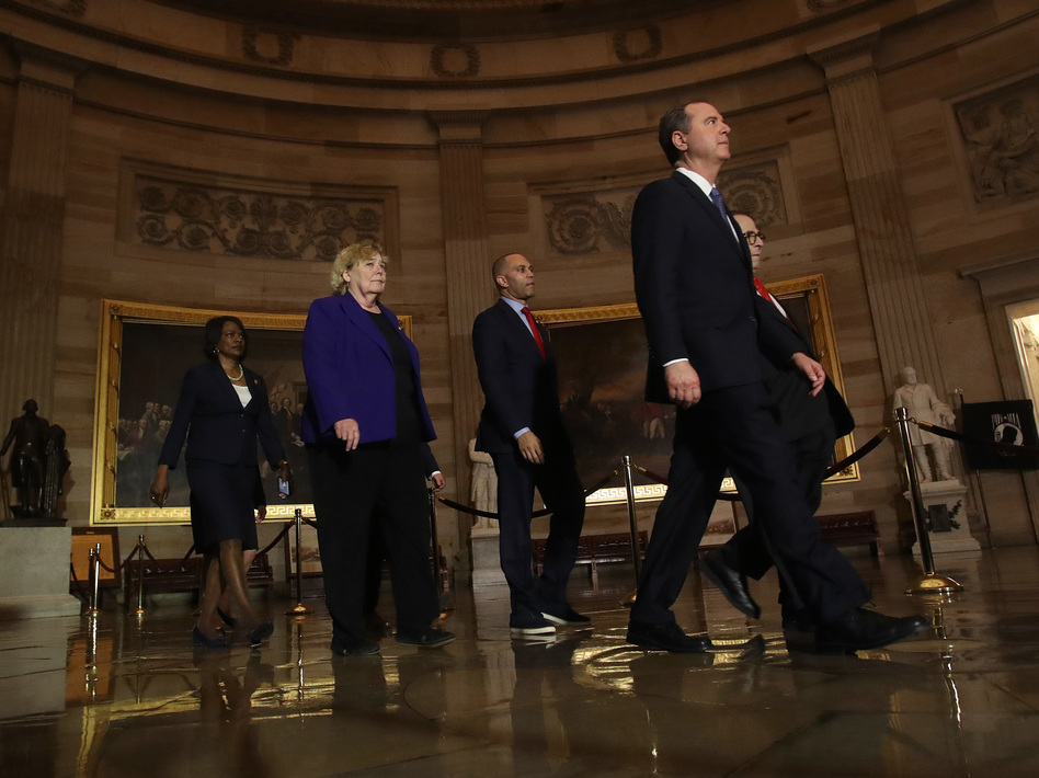 House managers accompany the articles of impeachment against President Trump as they are carried through the rotunda of the U.S. Capitol from the House of Representatives to the Senate on Jan. 15, 2020. (Win McNamee/Getty Images)
