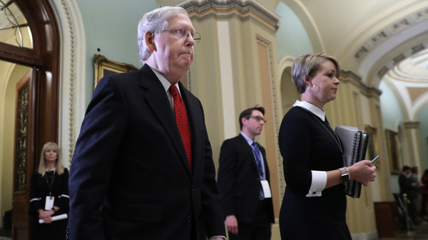 Senate Majority Leader Mitch McConnell, R-Ky., walks out of the Senate Chamber before the start of President Trump