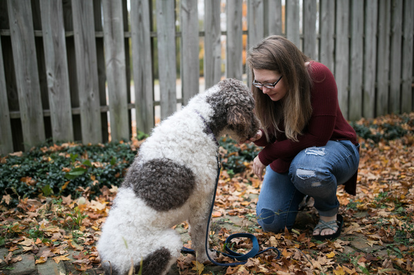 Jessica Moye spends time with Hachi in her yard outside Columbus, Ohio, on Oct. 30. Moye helps run a Facebook group dedicated to complaints about the company Diabetic Alert Dogs of America.
