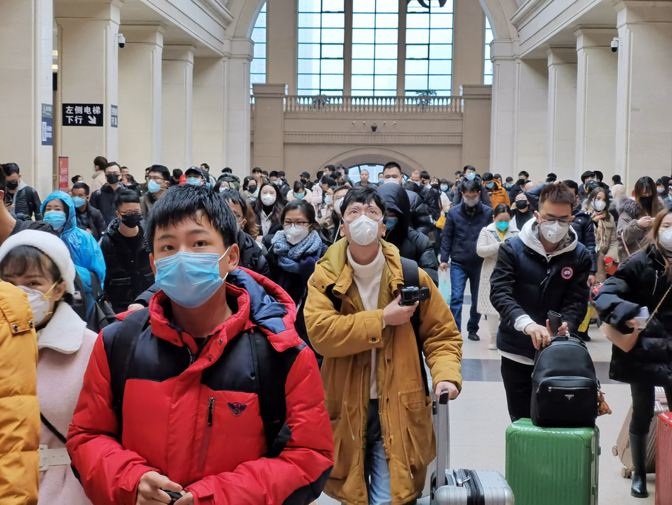 People wear face masks as they wait at Hankou Railway Station earlier this week in Wuhan, China. Experts say there is little evidence that masks prevent infection. (Xiaolu Chu/Getty Images)