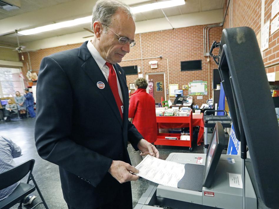 Then-Secretary of State Delbert Hosemann electronically cast his ballot in Jackson, Miss., on Nov. 5, 2019. (Rogelio V. Solis/AP)