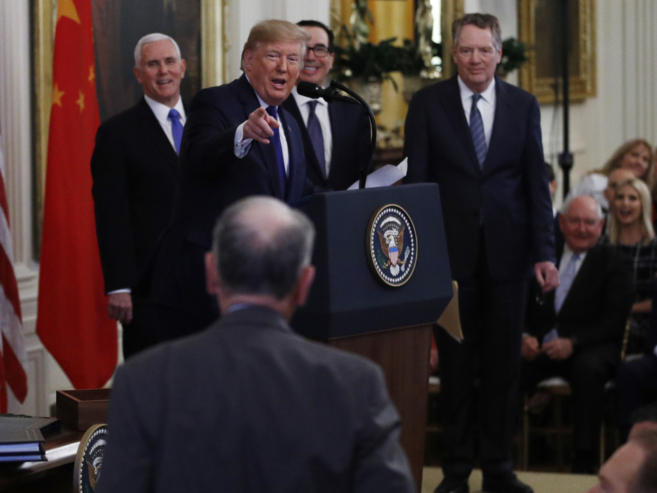 President Trump points to Sen. Chuck Grassley, R-Iowa, during a trade deal signing ceremony with Chinese officials earlier this month. (Steve Helber/AP)