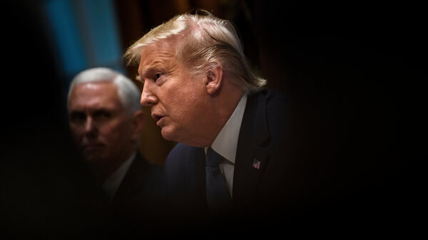 President Trump addresses a Cabinet meeting last month at the White House, as Vice President Pence looks on in the background. On Friday, the Trump administration suggested some of California's federal funds could be in jeopardy over the state's requirement that insurers cover abortions.