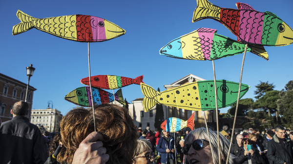 Protesters wearing Sardines, figurines and banners join the first national rally organized by the Sardine Movement in San Giovanni Square, on Dec. 14, 2019 in Rome.