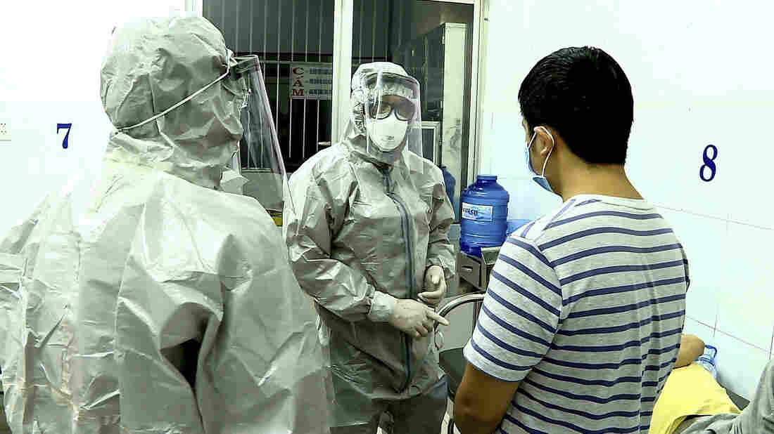 Medical personnel wearing protective suits interact with patients that tested positive to the coronavirus in an isolation room at Cho Ray hospital in Ho Chi Minh City, Vietnam on January 23, 2020.