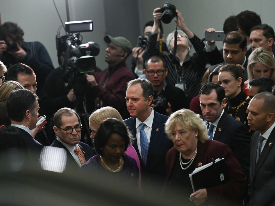 House Manager Adam Schiff (center) leaves after speaking to reporters during the Senate impeachment trial of President Trump Friday. (Andrew Caballero-Reynolds/AFP via Getty Images)